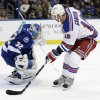Tampa Bay Lightning goalie Mathieu Garon (32) makes a save on a breakaway by New York Rangers right wing Marian Gaborik (10), of Slovakia, during the first period of an NHL hockey game on Saturday, Feb. 2, 2013, in Tampa, Fla. (AP Photo/Chris O\'Meara)