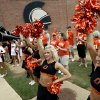 Members of the OSU Spirit Squad cheer during a pep rally before the college football game between the Troy University Trojans and the Oklahoma State University Cowboys at Movie Gallery Veterans Stadium in Troy, Ala., Friday, September 14, 2007. BY MATT STRASEN, THE OKLAHOMAN