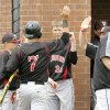 Verdigris\' Ryan Skalnik is congratulated by teammates after scoring a run during the Class 3A state baseball tournament between Verdigris and Oklahoma Christian at Deer Creek High School in Oklahoma City, OK, Thursday, May 9, 2013, By Paul Hellstern, The Oklahoman