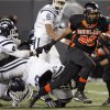 Aliston Cobb (20) of Douglass breaks away from Kenneth Davis Jr. (41) of Star Spencer on a touchdown run in the second quarter during the Class 4A high school football state championship game between Star Spencer and Douglass at Boone Pickens Stadium in Stillwater, Okla., Saturday, December 5, 2009. Photo by Nate Billings, The Oklahoman