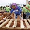 Marie Hopkins spaces planks evenly atop two supports to make a platform on the playground equipment. Organizers said about 140 volunteers from Partners in Public Health, Blue Cross and Blue Shield of Oklahoma, organizers from KaBOOM! and residents of the Oklahoma City community will provided the labor on Saturday, June 8, 2013, to build a new playground at the Northeast Regional Health and Wellness Center on NE 63 Street, east of MLK Blvd. The new playground\'s design is based on drawings created by children who participated in a Design Day event in April. Photo by Jim Beckel, The Oklahoman.