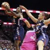 Connecticut Sun\'s Ebony Hoffman, left, and Kelly Faris grab for a rebound over San Antonio Stars\' Becky Hammon during the first half of a WNBA basketball game, Friday Aug. 1, 2014 at the AT&T Center in San Antonio. (AP Photo/The San Antonio Express-News, Edward A. Ornelas) RUMBO DE SAN ANTONIO OUT; NO SALES