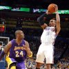 Oklahoma City\'s Russell Westbrook (0) shoots as Lakers\' Kobe Bryant (24) defends during the NBA basketball game between the Oklahoma City Thunder and the Los Angeles Lakers, Sunday, Feb. 27, 2011, at the Oklahoma City Arena.Photo by Sarah Phipps, The Oklahoman ORG XMIT: KOD