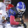 Photo - Deer Creek's Alec James rushes as Carl Albert's Isaiah Shawver tackles him  during the high school football game between Deer Creek and Carl Albert at Deer Creek High School, Friday, Sept. 21, 2012.  Photo by Sarah Phipps, The Oklahoman
