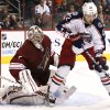 Columbus Blue Jackets\' Artem Anisimov (42), of Russia, tries to control the puck in front of Phoenix Coyotes\' Jason LaBarbera during the second period in an NHL hockey game on Wednesday, Jan. 23, 2013, in Glendale, Ariz. (AP Photo/Ross D. Franklin)