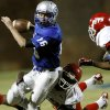 Guthrie\'s Bryan Dutton is brought down by Western Heights\' Devontae Henderson during their high school football game in Guthrie on Friday, Oct. 28, 2011. Photo by John Clanton, The Oklahoman