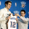 Thunder executive vice president and general manager Sam Presti gives new center Nenad Krstic his Oklahoma City Thunder jersey, Tuesday, Dec. 30, 2008, at the Thunder practice facility in Oklahoma City. PHOTO BY SARAH PHIPPS, THE OKLAHOMAN ORG XMIT: KOD