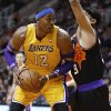 Los Angeles Lakers\' Dwight Howard (12) backs down Phoenix Suns\' Jared Dudley during the first half on an NBA basketball game, Wednesday, Jan. 30, 2013, in Phoenix. (AP Photo/Matt York)