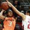 Texas Tech\'s Monique Smalls, right, looks to block a shot by Oklahoma State\'s Tiffany Bias during their NCAA college basketball game in Lubbock, Texas, Wednesday, Feb. 27, 2013. (AP Photo/The Avalanche-Journal, Stephen Spillman)