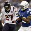Indianapolis Colts\' T.Y. Hilton (13) makes a 70-yard touchdown reception against Houston Texans\' Quintin Demps (27) during the second half of an NFL football game, Sunday, Dec. 30, 2012, in Indianapolis. (AP Photo/Michael Conroy)