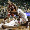 Baylor \'s Deuce Bello, bottom left, and Rico Gathers, bottom right, watch as A.J. Walton, center right, struggles with Oklahoma \'s Amath M\'Baye (22) for control of a rebound during the second half of an NCAA college basketball game Wednesday, Jan. 30, 2013, in Waco, Texas. Oklahoma won 74-71.
