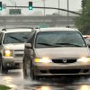 Photo - Traffic makes its way through heavy rain throughout the Jackson, Miss.,  area Sunday, April 6, 2014.  On Sunday, street flooding plagued Jackson. Flood advisories for much of the state continued into Monday. (AP Photo/The Clarion-Ledger, Rick Guy )  NO SALES