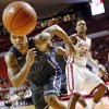 TCU\'s Adrick McKinney (24) chases a loose ball in front of Oklahoma\'s Romero Osby (24) during an NCAA men\'s basketball game between the University of Oklahoma (OU) and Texas Christian University (TCU) at the Lloyd Noble Center in Norman, Okla., Monday, Feb. 11, 2013. OU won, 75-48. Photo by Nate Billings, The Oklahoman