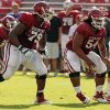 Daryl Williams (79) and Nila Kasitati (54) guard the quarterback during the University of Oklahoma Sooners (OU) practice and Student Day at Gaylord Family-Oklahoma Memorial Stadium in Norman, Okla., on Thursday, Aug. 21, 2014. Photo by Steve Sisney, The Oklahoman