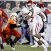 Oklahoma\'s DeMarco Murry (7) gets running room past Oklahoma State\'s Ricky Price (6) during the first half of the college football game between the University of Oklahoma Sooners (OU) and Oklahoma State University Cowboys (OSU) at Boone Pickens Stadium on Saturday, Nov. 29, 2008, in Stillwater, Okla. STAFF PHOTO BY CHRIS LANDSBERGER