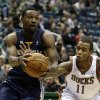 Photo -   Milwaukee Bucks' Monta Ellis (11) reaches in on Memphis Grizzlies' Tony Allen during the first half of an NBA basketball game, Wednesday, Nov. 7, 2012, in Milwaukee. (AP Photo/Jeffrey Phelps)