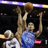Oklahoma City Thunder\'s Kevin Martin (23) shoots over Memphis Grizzlies\' Jerryd Bayless (7) during the first half of an NBA basketball game in Memphis, Tenn., Wednesday, March 20, 2013. (AP Photo/Danny Johnston)