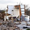 All the remains of a home damaged by Monday\'s tornado is a bathtub enclosure near Telephone road and SW 4th Street on Tuesday, May 21, 2013 in Moore, Okla. Photo by Steve Sisney, The Oklahoman