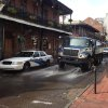 Photo - A Progressive Waste Solutions truck sprays along Bourbon Street, following a shooting earlier in the day, Sunday, June 29, 2014, in New Orleans. Nine people were shot on Bourbon Street in New Orleans' celebrated French Quarter, leaving at least one person in critical condition. (AP Photo/NOLA.com/The Times-Picayune, Benjamin Alexander-Bloch) MAGS OUT; NO SALES; USA TODAY OUT; THE BATON ROUGE ADVOCATE OUT