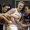 Gonzaga\'s Sunny Greinacher, left, grabs the ball away from Iowa State\'s Anna Prins as Gonzaga\'s Meghan Winters, right, watches in the first half during a first-round game in the women\'s NCAA college basketball tournament in Spokane, Wash., Saturday, March 23, 2013. (AP Photo/Elaine Thompson)