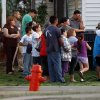A crowd gathers down the street from a home in the 1900 block of NW 15 where three bodies were found in Oklahoma City, Tuesday, March 13, 2012. Photo by Bryan Terry, The Oklahoman