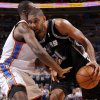 San Antonio\'s Tim Duncan (21) tries to get past Serge Ibaka (9) during Game 6 of the Western Conference Finals between the Oklahoma City Thunder and the San Antonio Spurs in the NBA playoffs at the Chesapeake Energy Arena in Oklahoma City, Wednesday, June 6, 2012. Photo by Bryan Terry, The Oklahoman