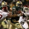 Baylor running back Terrance Ganaway (24) breaks through a tackle attempt by Oklahoma linebacker Travis Lewis (28) for extra yardage on a long run in the first half of an NCAA college football game on Saturday, Nov. 19, 2011, in Waco, Texas. (AP Photo/Tony Gutierrez)