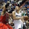 Minnesota Timberwolves\' Lou Amundson, right, eyes the basket as Chicago Bulls\' Taj Gibson defends during the first half of an NBA preseason basketball game, Saturday, Oct. 13, 2012, in Minneapolis. (AP Photo/Jim Mone)