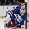 Photo - New York Rangers goalie Henrik Lundqvist (30), of Sweden, stops a shot on the goal during the first period of an NHL hockey game against the Columbus Blue Jackets, Monday, Jan. 6, 2014, in New York. (AP Photo/Frank Franklin II)