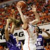 OSU\'s Lindsey Keller (25) moves to the hoop between James Madison\'s Toia Giggetts (3), left, and Lauren Whitehurst (15) during the Women\'s NIT championship college basketball game between Oklahoma State University and James Madison at Gallagher-Iba Arena in Stillwater, Okla., Saturday, March 31, 2012. OSU won, 75-68. Photo by Nate Billings, The Oklahoman