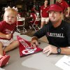 Lilly Bittner, 2, from Oklahoma City, poses for a picture with head football coach Bob Stoops during fan appreciation day for the University of Oklahoma Sooner (OU) football team at Gaylord Family-Oklahoma Memorial Stadium in Norman, Okla., on Saturday, Aug. 3, 2013. Photo by Steve Sisney, The Oklahoman