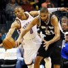 Oklahoma City\'s Russell Westbrook (0) steals the ball from San Antonio\'s Tim Duncan (21) during an NBA basketball game between the Oklahoma City Thunder and the San Antonio Spurs in Oklahoma City Monday, Dec. 17, 2012. Oklahoma City won, 107-93. Photo by Nate Billings, The Oklahoman