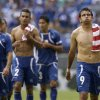 El Salvador\'s Rafael Burgos, right, walks off the field with teammates after losing 5-1 to the United States in the quarterfinals of the CONCACAF Gold Cup soccer tournament on Sunday, July 21, 2013, in Baltimore. (AP Photo/Patrick Semansky)