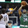 Milwaukee Bucks\' Monta Ellis (11) defends as Boston Celtics\' Paul Pierce (34) shoots a three-point basket during the first half of an NBA basketball game, Saturday, Nov. 10, 2012, in Milwaukee. (AP Photo/Jim Prisching)