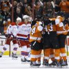 Photo - Philadelphia Flyers' players celebrate after a goal by Jakub Voracek, of the Czech Republic, during the first period of an NHL hockey game against the Washington Capitals, Wednesday, March 5, 2014, in Philadelphia. (AP Photo/Matt Slocum)