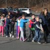 Photo - FILE - In this Friday, Dec. 14, 2012 file photo provided by the Newtown Bee, Connecticut State Police lead a line of children from the Sandy Hook Elementary School in Newtown, Conn. after Adam Lanza opened fire, killing 26 people, including 20 children.  State's Attorney Stephen Sedensky III asked a judge in Danbury Superior Court, Wednesday, March 27, 2013 to limit the information to be made public from warrants in Newtown school shooting, due to be released Thursday. (AP Photo/Newtown Bee, Shannon Hicks, File) MANDATORY CREDIT: NEWTOWN BEE, SHANNON HICKS