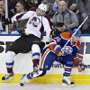 Colorado Avalanche\'s Patrick Bordeleau (58) misses the check on Edmonton Oilers\' Ryan Smyth during the second period of their NHL hockey game, Monday, Jan. 28, 2013, in Edmonton, Alberta. (AP Photo/The Canadian Press, Jason Franson)