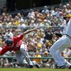 Pittsburgh Pirates first baseman Ike Davis, right, and Washington Nationals\' Anthony Rendon, left, collide during a rundown between first and second during the third inning of a baseball game in Pittsburgh Sunday, May 25, 2014. Rendon was awarded second base on the error by Davis. (AP Photo/Gene J. Puskar)