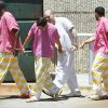 Photo - Cleveland County inmates wear jail-issue uniforms. PHOTO BY STEVE SISNEY, THE OKLAHOMAN