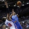 Oklahoma City Thunder guard Russell Westbrook (0) drives on Detroit Pistons center Greg Monroe (10) in the first half of an NBA basketball game in Auburn Hills, Mich., Monday, Nov. 12, 2012. (AP Photo/Paul Sancya) ORG XMIT: MIPS101