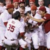 Sooners mob teammate Cody Reine, right, after his hit to drive in two runs in the bottom of the ninth inning to give the Sooners a 3-2 win over Kansas in the fourth game of the Big 12 Baseball Championship between Oklahoma and Kansas at the Bricktown Ballpark on Wednesday, May 26, 2010, in Oklahoma City, Okla. Photo by Chris Landsberger, The Oklahoman