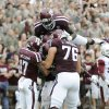 Texas A&M players celebrate a touchdown against Arkansas during the third quarter of an NCAA college football game Saturday, Sept. 29, 2012, in College Station, Texas. A&M won 58-10. (AP Photo/Pat Sullivan)