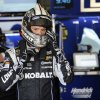 Photo - Jimmie Johnson adjusts his helmet during practice for the NASCAR Sprint Cup series auto race, Saturday, May 31, 2014, at Dover International Speedway in Dover, Del. (AP Photo/Nick Wass)
