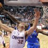 Oklahoma City Thunder power forward Serge Ibaka, right, of Congo tries to block the shot of Los Angeles Clippers power forward Blake Griffin during the first half of their NBA basketball game, Saturday, April 2, 2011, in Los Angeles. (AP Photo/Mark J. Terrill) ORG XMIT: LAS111