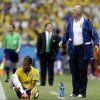 Photo - Brazil's coach Luiz Felipe Scolari, right, stands on the touchline with Brazil's Neymar during the group A World Cup soccer match between Brazil and Mexico at the Arena Castelao in Fortaleza, Brazil, Tuesday, June 17, 2014. (AP Photo/Andre Penner)