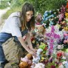 Photo - MURDERS, SHOOTING DEATHS, TAYLOR PLACKER, TAYLOR DAWN PASCHAL-PLACKER , SKYLA JADE WHITAKER, WELEETKA: Elizabeth Harjo leaves a stuffed animal at  the memorial for Taylor Paschal-Placker and her friend  Skyla Whitaker, Monday, June 16, 2008.  The girls were murdered while walking on a dirt road near one of their homes  Photo by David McDaniel/The Oklahoman    ORG XMIT: KOD