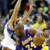 Photo - Los Angeles Lakers' Kobe Bryant, right, drives around Minnesota Timberwolves' Ricky Rubio, of Spain, in the first quarter of an NBA basketball game, Friday, Feb. 1, 2013, in Minneapolis. (AP Photo/Jim Mone)