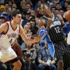Dwight Howard (12) of Orlando looks to get around the defense of Oklahoma City\'s Nick Collison (4) during the NBA basketball game between the Orlando Magic and Oklahoma City Thunder in Oklahoma City, Thursday, January 13, 2011. Photo by Nate Billings, The Oklahoman