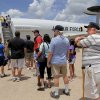 Billy Seabourn, a US Navy veteran who lives in Columbus, Georgia, waits in a long line for a chance to see the inside of this E-3 Sentry and talk to crew members inside. Seabourn once lived in Oklahoma City but has since moved out of state. He is in town visiting his brother who lives in Moore. Base officials estimate more than 100,000 visitors will attend Tinker Air Force Base\'s annual Star Spangled Salute Air Show and Open House this Saturday and Sunday, June 21 and 22, 2014. The Air Force Thunderbirds, a military precision flying team, thrilled spectators with their close formations and daredevil-type flying Saturday afternoon. Organizers say the public will have an opportunity to view the largest collection of static displays in the history of the event. Hundreds stood in long lines in hot and humid conditions to walk through the E-3 Sentry on Saturday. Visitors also were able to get close looks at other military aircraft, including the B-1B Lancer, B-52 Stratofortress, C-17 Globemaster, CV-22 Osprey, E-6B Mercury, KC-135 Stratotanker. The event continues on Sunday, with aerial acts starting at noon. Photo by Jim Beckel, The Oklahoman
