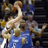 Memphis\' Marc Gasol (33) passes away from the defense of Oklahoma City\'s Derek Fisher (6) and Kevin Durant (35) in the first half during Game 4 of the second-round NBA basketball playoff series between the Oklahoma City Thunder and the Memphis Grizzlies at FedExForum in Memphis, Tenn., Monday, May 13, 2013. Photo by Nate Billings, The Oklahoman